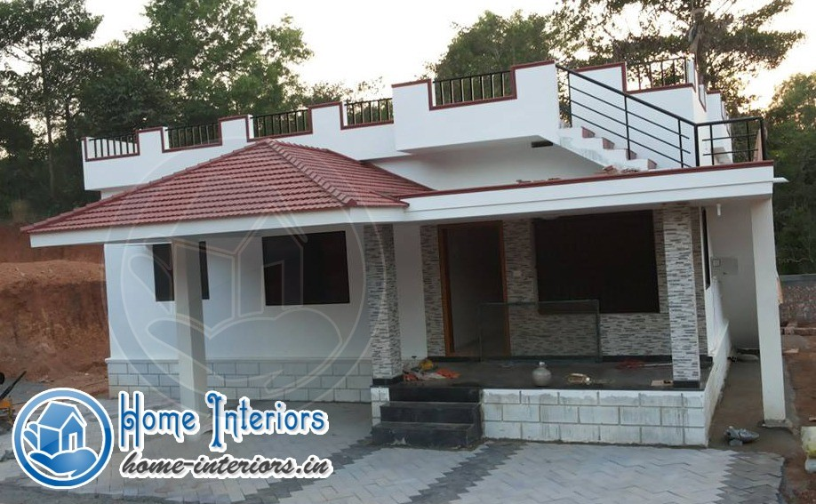 918 sq ft beautiful low budget home design for Kerala low budget house plans with photos free